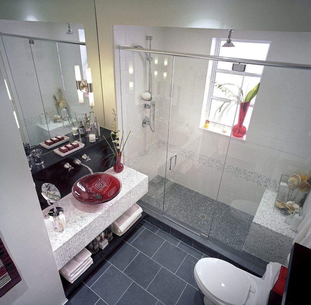 SH10K120DIVINEDESIGN Nov. 22, 2010 - Sleek finishes, updated lighting and a red glass basin turned a washed-out bathroom into an oasis. (SHNS file photo courtesy HGTV)