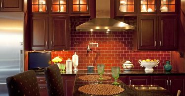 Elegant Modern Marble Countertop Kitchen With Red Brick Wall Design