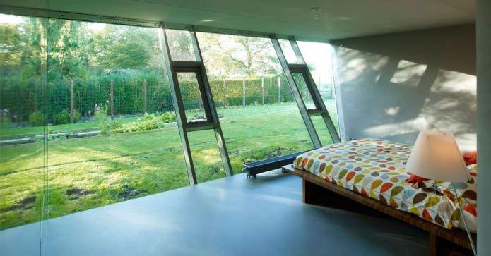 Къщата на необичайна форма на VMX Architects Studio