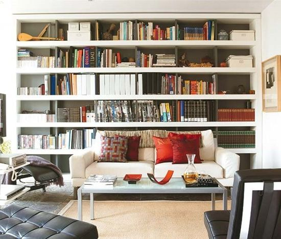 How to use the wall above the sofa in the living room: ideas for small apartments