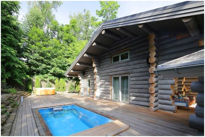 wooden house from logs with pool