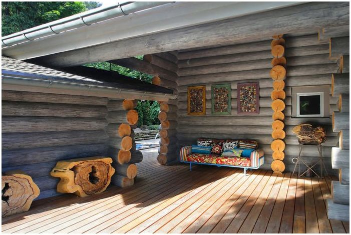 wooden house from logs with a terrace