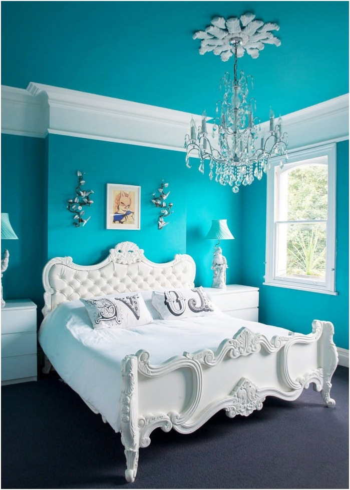 bedroom interior with turquoise walls and ceiling