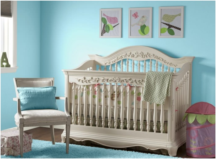 Interior nursery for a newborn with turquoise walls