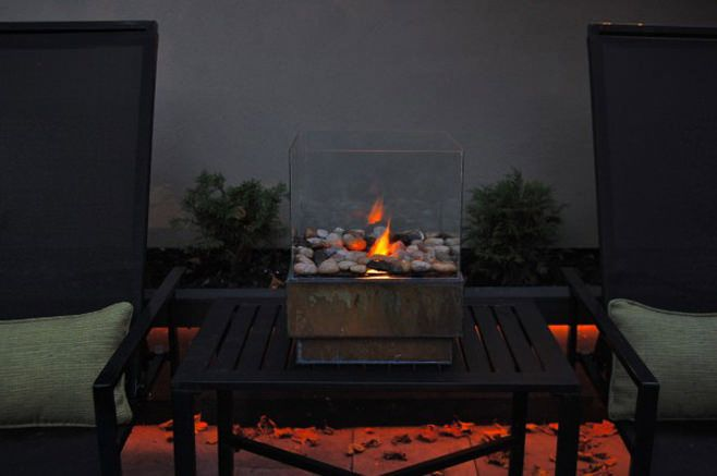 outdoor fireplace with his hands