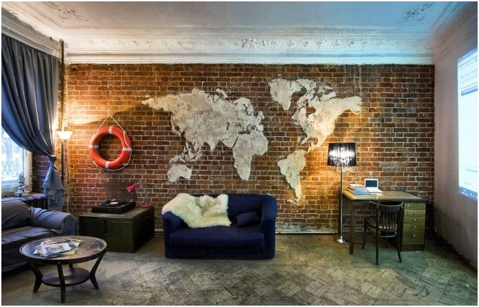 map of the world in the interior of the living room in the loft
