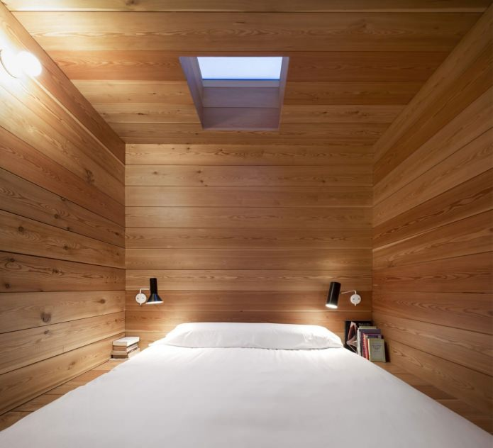 bedroom in the interior of a modern house with a flat roof