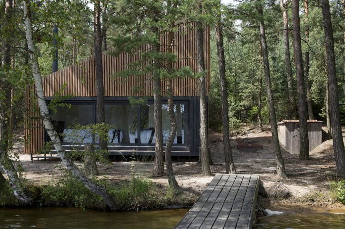 The modern design of a small private house in the woods