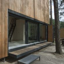 The modern design of a small private house in the woods 1