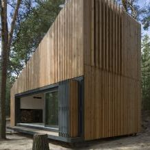 The modern design of a small private house in the woods 4
