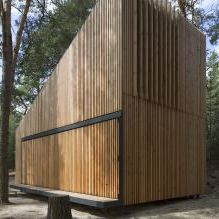 The modern design of a small private house in the woods-6