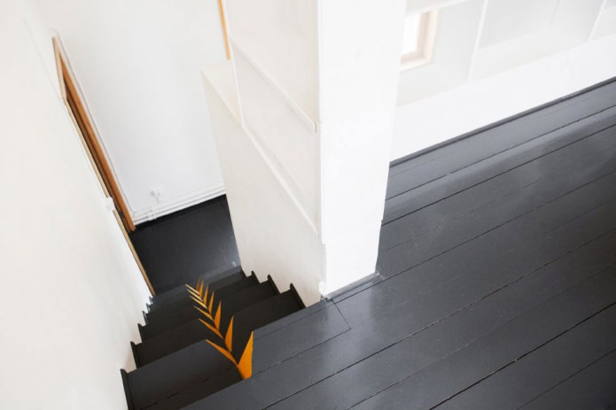unusual staircase in the country house in the style of minimalism