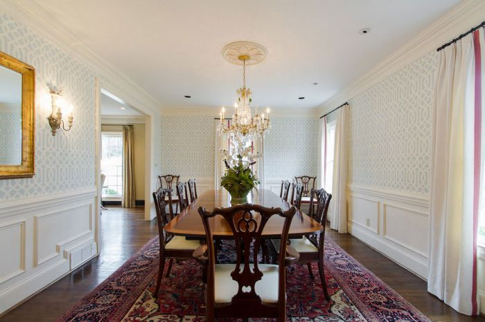Wallpaper on the walls in the dining room add warmth to the room and make it more comfortable.