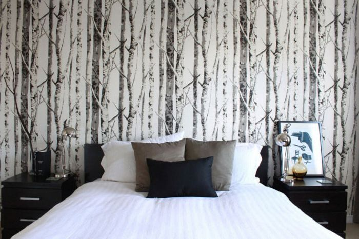 Images of nature on the wallpaper in the bedroom create an intimate and cozy atmosphere.