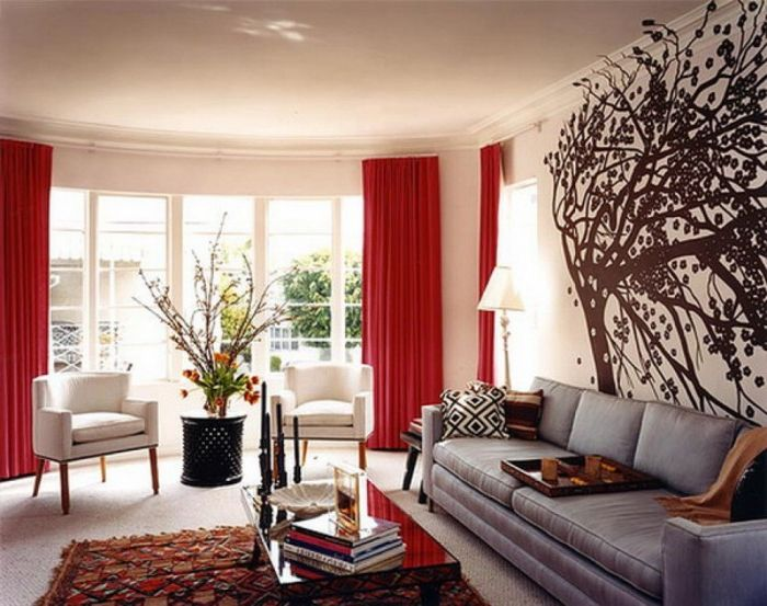 Stencil - an easy and affordable way to liven up the interior of the living room.