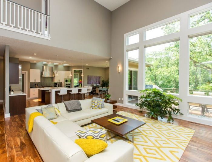 Yellow pillows, rugs and curtains will add vitality and energy of the living room.
