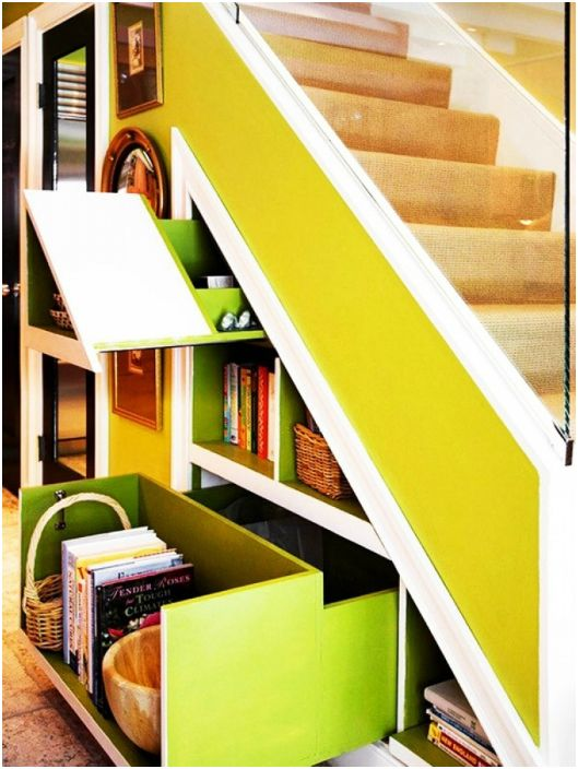 Bright staircase with sliding wardrobes, cupboards and shelves.