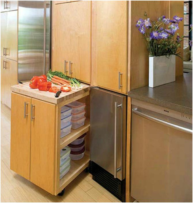 Pull-out kitchen cabinet on wheels, which will provide an additional kitchen work surface.