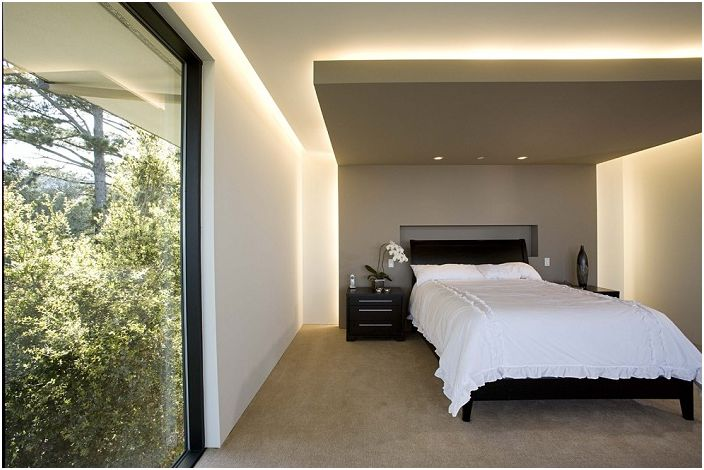 "Interesting design of ""floating"" ceiling in the bedroom with a hidden lighting."