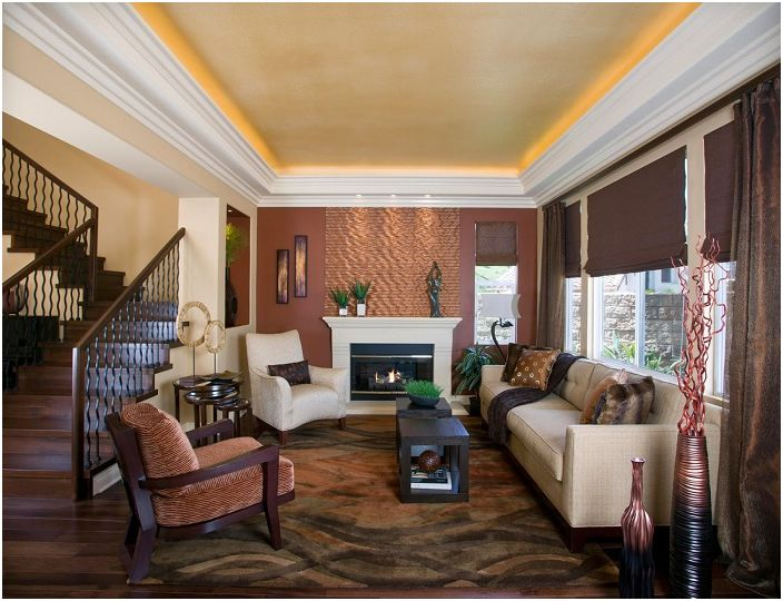 Chocolate tones in the design of the living room in a modern style further emphasizes the concealed lighting.