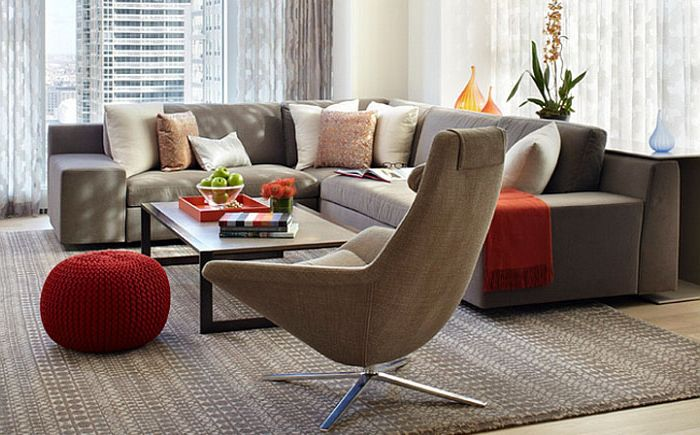 Living room with red accents by Jessica Lagrange