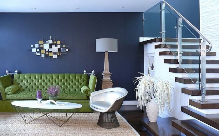 Green sofa in the living room of a blue Dotter & Solfjeld Architecture + Design