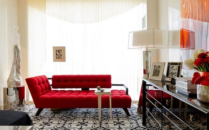 Stylish red sofa in the living room by Charles Pavarini III Design Associates