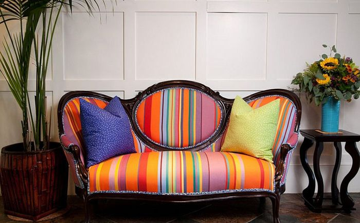 Multi-colored sofa in the living room by Darci Goodman Design