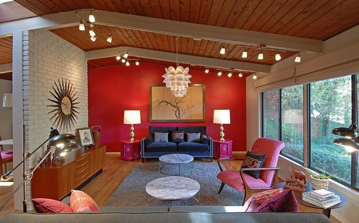 Red and bright pink in the interior of the living room from Brian Patterson Designs