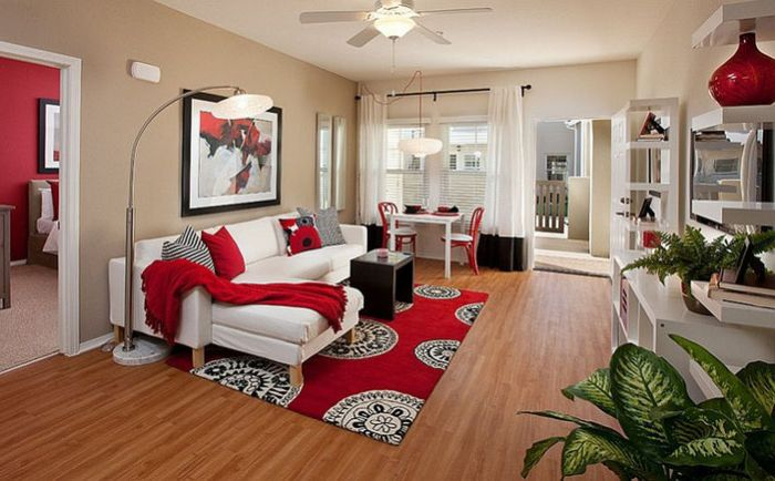 Living room with red accents on the Borden Interiors & Associates
