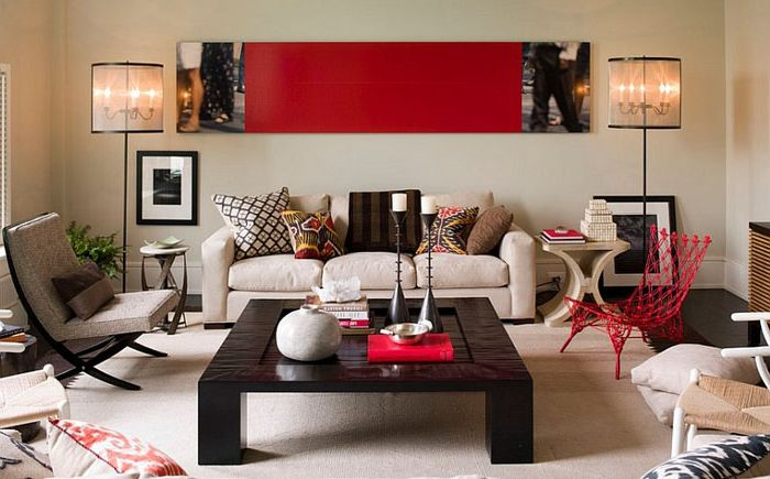 Modern living room with red accents on the Thom Filicia