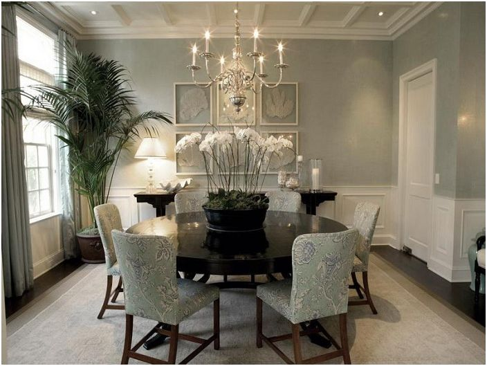 Dining in a greenish-olive colors with elegant chandelier that complements the interior.