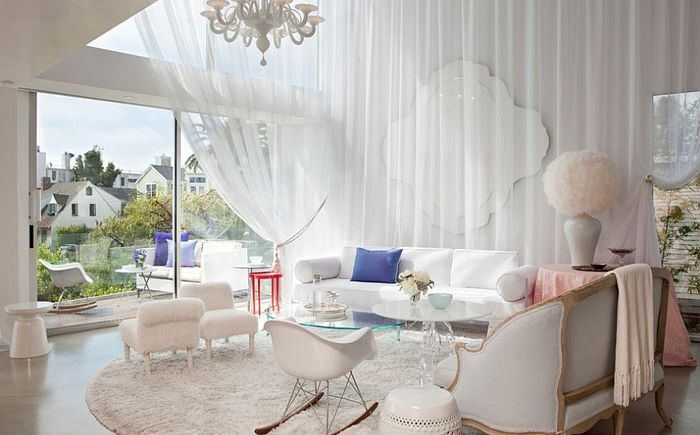 White draped fabric gives the living room a female charm