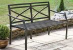 Metal bench in landscape garden design