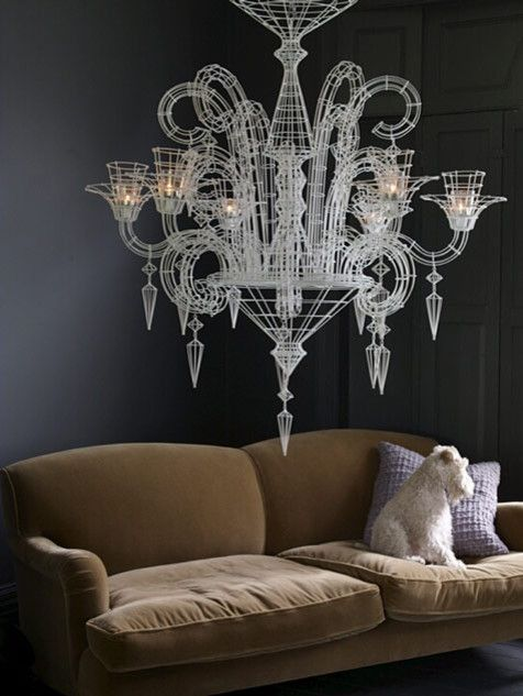 The magnificent chandelier hanging in the interior of Abigail Ahern