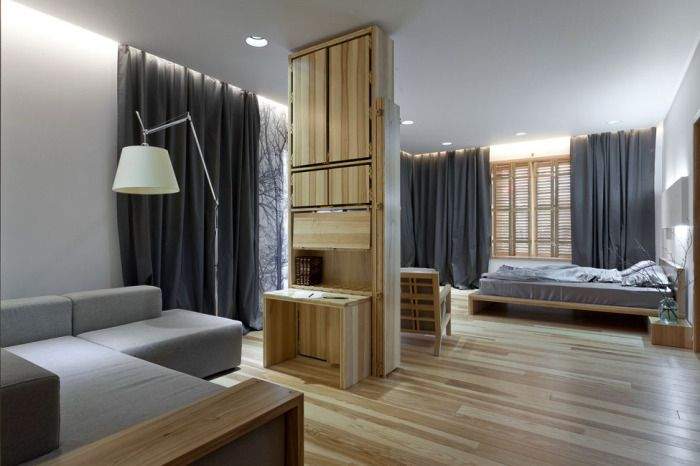 Bedroom is not separated from the living room - a good solution for small apartments.