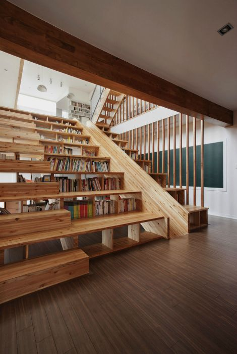 Home library under the stairs.