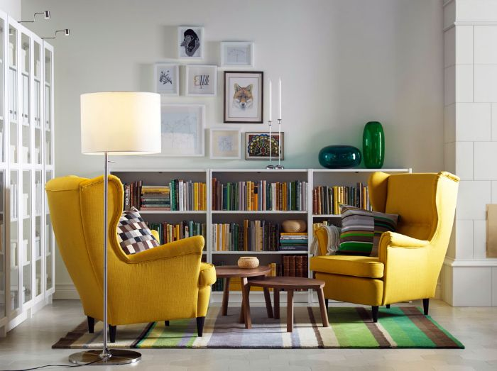 Living room with bright yellow armchairs.