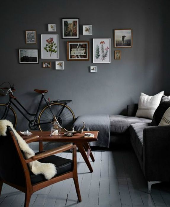 A small living room with gray walls.