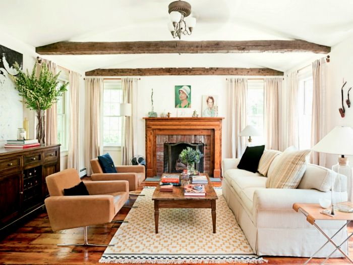 The spacious living room with rustic elements.