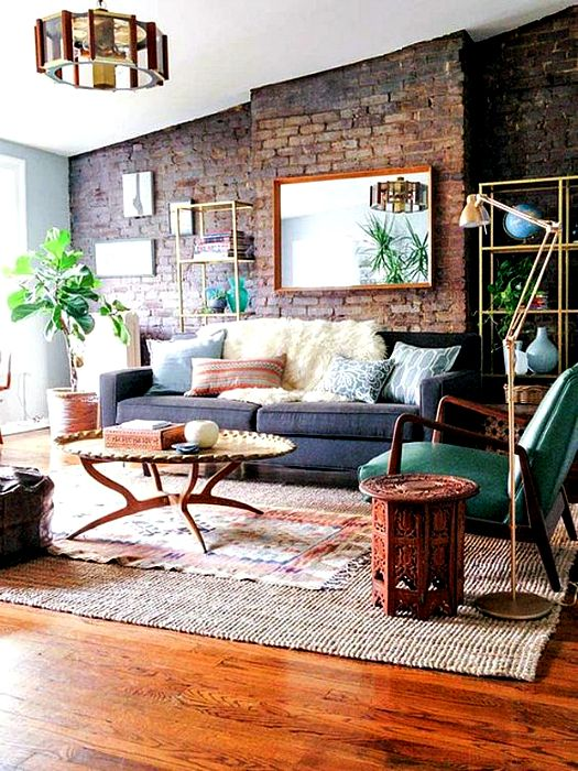 Stylish living room with a brick wall.