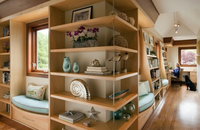 Shelves visually combine two rooms.