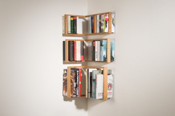 Shelf securely holds books.