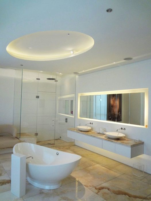 Bathroom decorated with concealed lighting, adds a touch of charm.