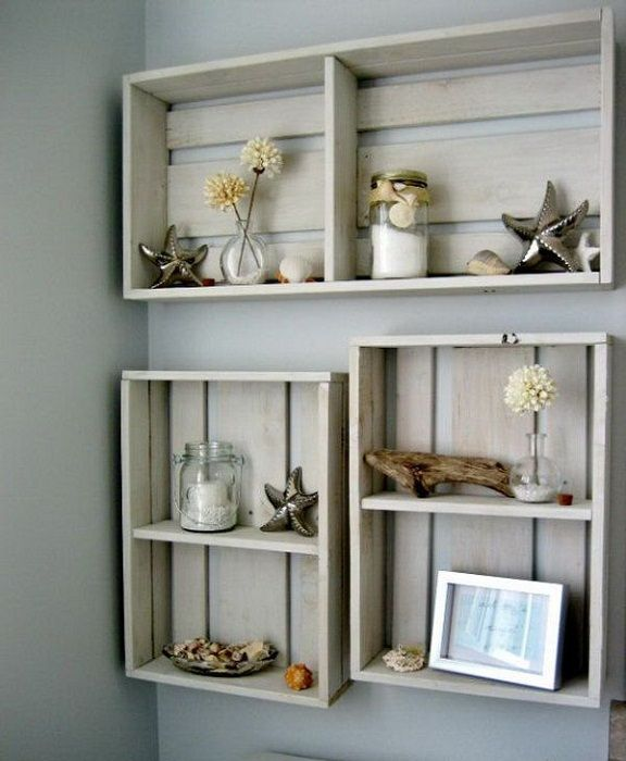 Unusual wall shelves of conventional wooden boxes.