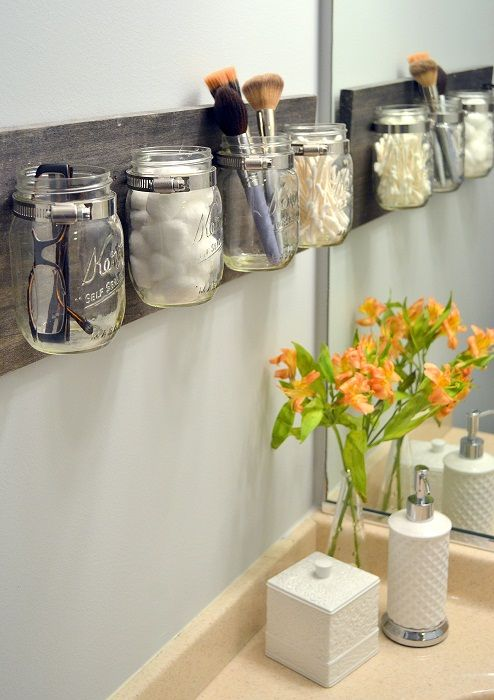Proper storage of things in the bathroom will help to optimize the space.
