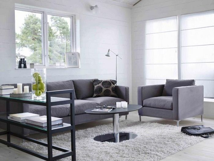 Grey color scheme and original furnishings - features a tiny living room.