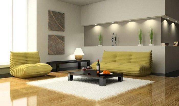In the small living room, using a low-profile furniture that visually enhances the space.