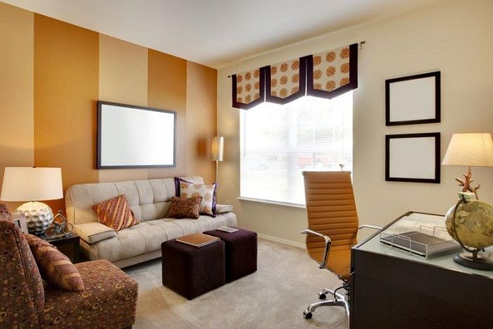Orange and cream colors of the living room is filled with a small space a warm and cozy atmosphere.