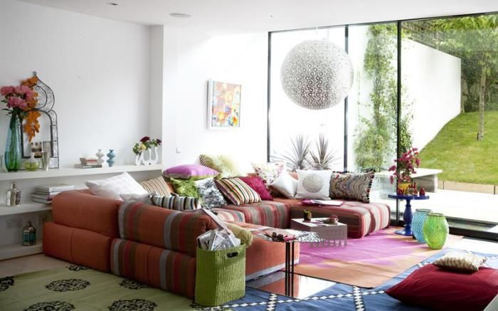The use of bright colors and unusual design elements makes the interior features a tiny living room.